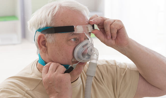 Senior Man with sleeping apnea and CPAP