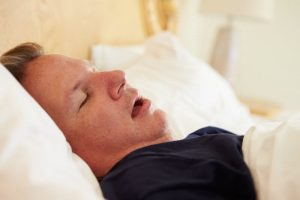 Overweight Man Asleep In Bed