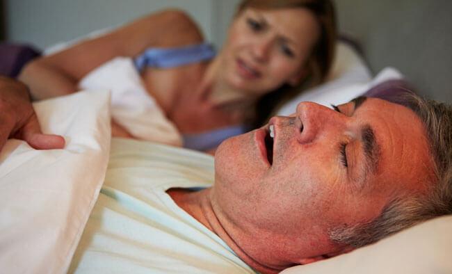 Man Keeping Woman Awake In Bed With Snoring