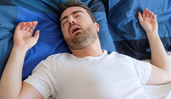 Man in bed suffering for sleep