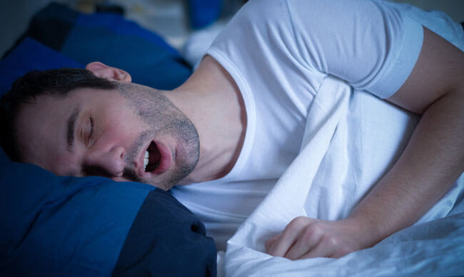 man sleeping and snoring loudly