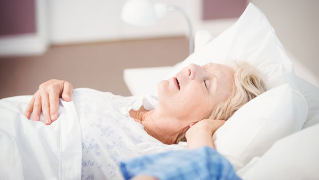 woman snoring in the bed
