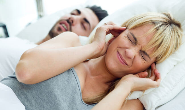 woman who can not sleep because her husband snores